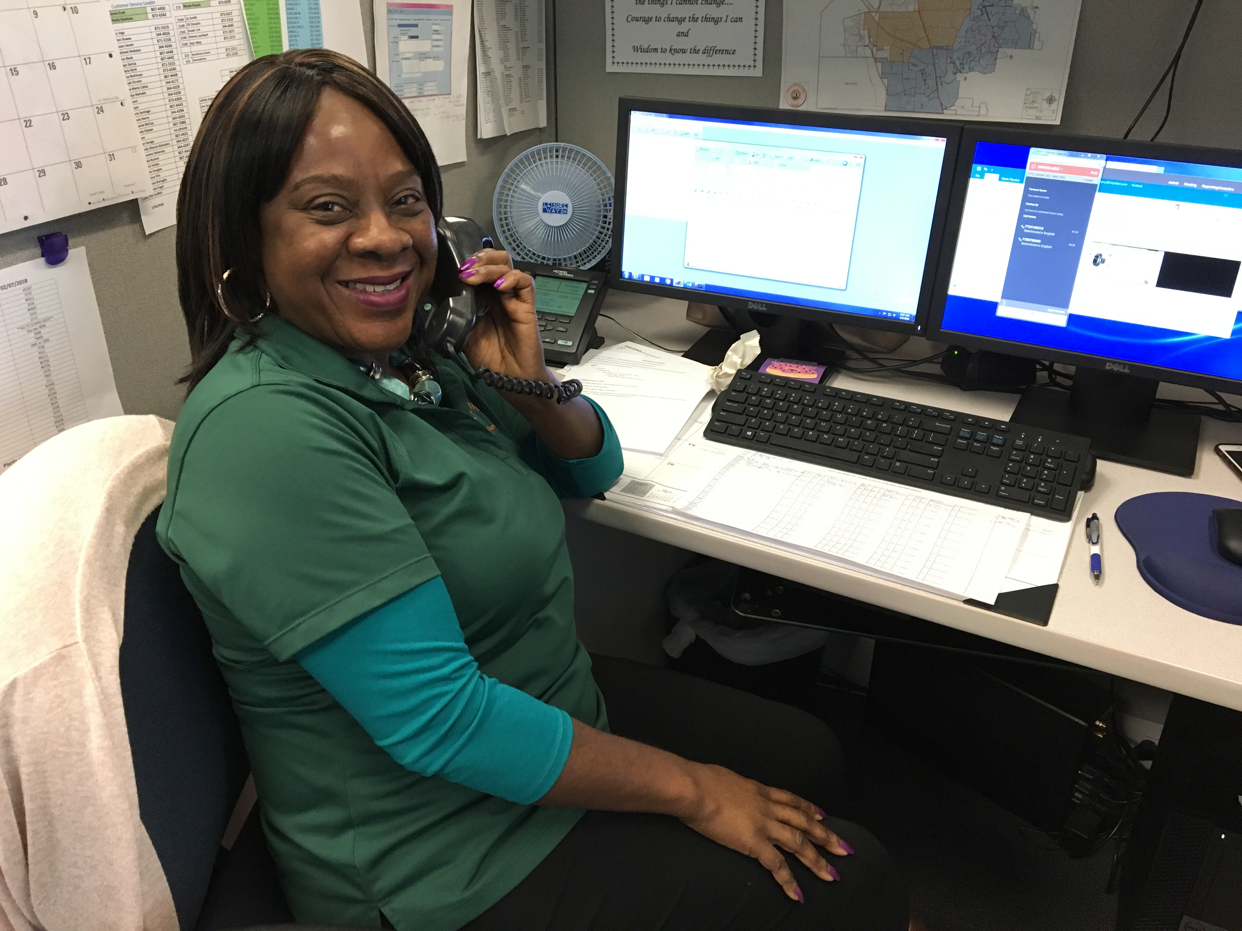 Customer Service Specialist smiling while speaking to a customer on the phone