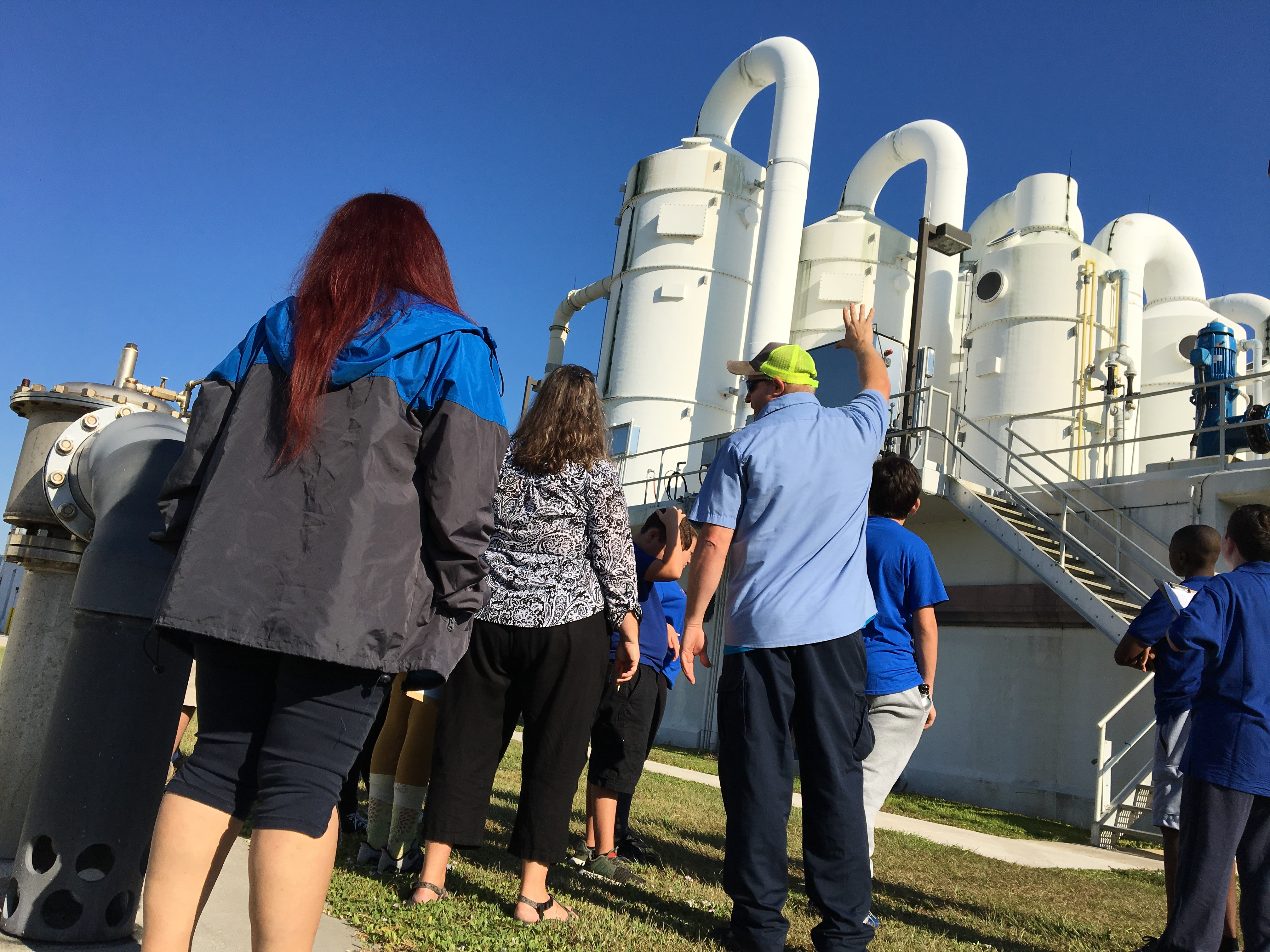 Middle schoolers filter through water treatment plant