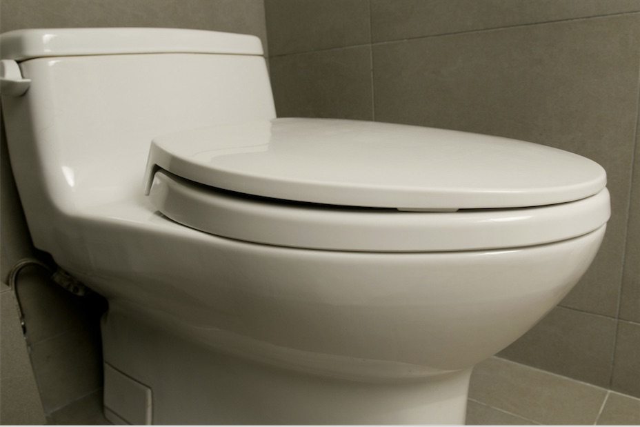 white toilet in residential bathroom